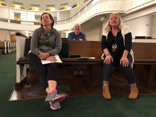 """Cast members Donna B. Stinnett, left, and Stacey Howell, right — who is sharing director duties in the musical play """"Another Day in Heaven"""" — and creator Bob Park watch the rehearsal of a scene earlier this month. The play will be presented April 27 at the Preston Arts Center."""