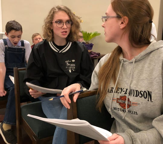 """Struggling eighth-grader Frances (center, portrayed by Emily Hayes), expresses skepticism over the claim by classmate Betty Sue (right, Brandi Downey) that she thinks she is being visited by the spirit of a dead boy while bored classmate Owen (Nate Gold) fails to stifle a yawn during a rehearsal of Bob Park's play """"Another Day in Heaven."""" Frances is a central figure in the story about how angels seek to help people on Earth."""