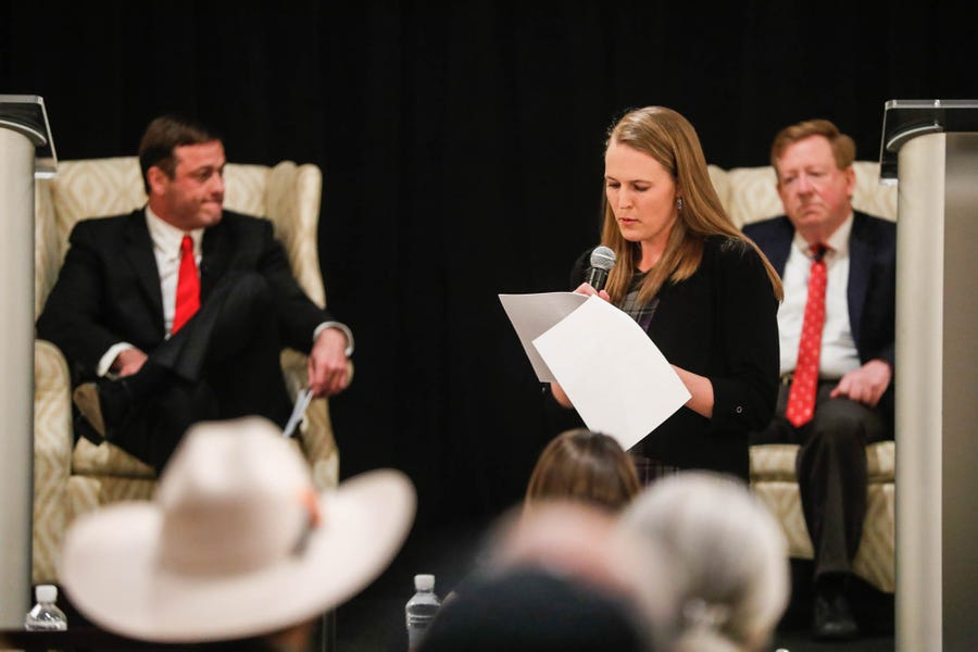 Current in Carmel Managing Editor Ann Marie Shambaugh, center, moderates the Carmel Ind. public debate between Carmel's two mayoral candidates, incumbent Jim Brainard, right, and challenger Fred Glynn, left, a Hamilton County councilor, at the Ritz Charles on Tuesday, April 16, 2019.