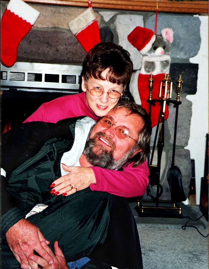 """Earl """"Butch"""" Kimmerling and his wife, Sandy hug for a picture from Christmas 1998."""