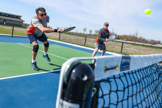 "plays a game of pickleball at Cyntheanne Park in Fishers, Ind., Tuesday, April 16, 2019. Fishers resident Steve Cage recently donated $63,000 to Fishers Parks & Recreation and the Fishers Parks Foundation for the addition of two new ""challenge"" courts, geared toward intermediate and advanced players."