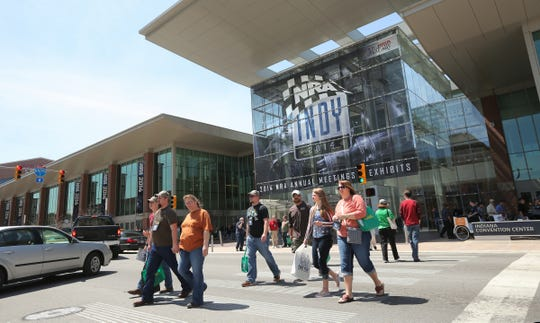 People head outside in Downtown Indianapolis, during the NRA Convention at the Indiana Convention Center on April 25, 2014.