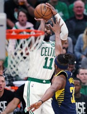 Boston Celtics guard Kyrie Irving (11) shoots over Indiana Pacers center Myles Turner (33) during the first quarter of Game 2 of an NBA basketball first-round playoff series, Wednesday, April 17, 2019, in Boston.