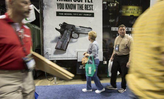 Patrons attend the NRA's annual convention at the Indiana Convention Center in Indianapolis on April 25, 2014.
