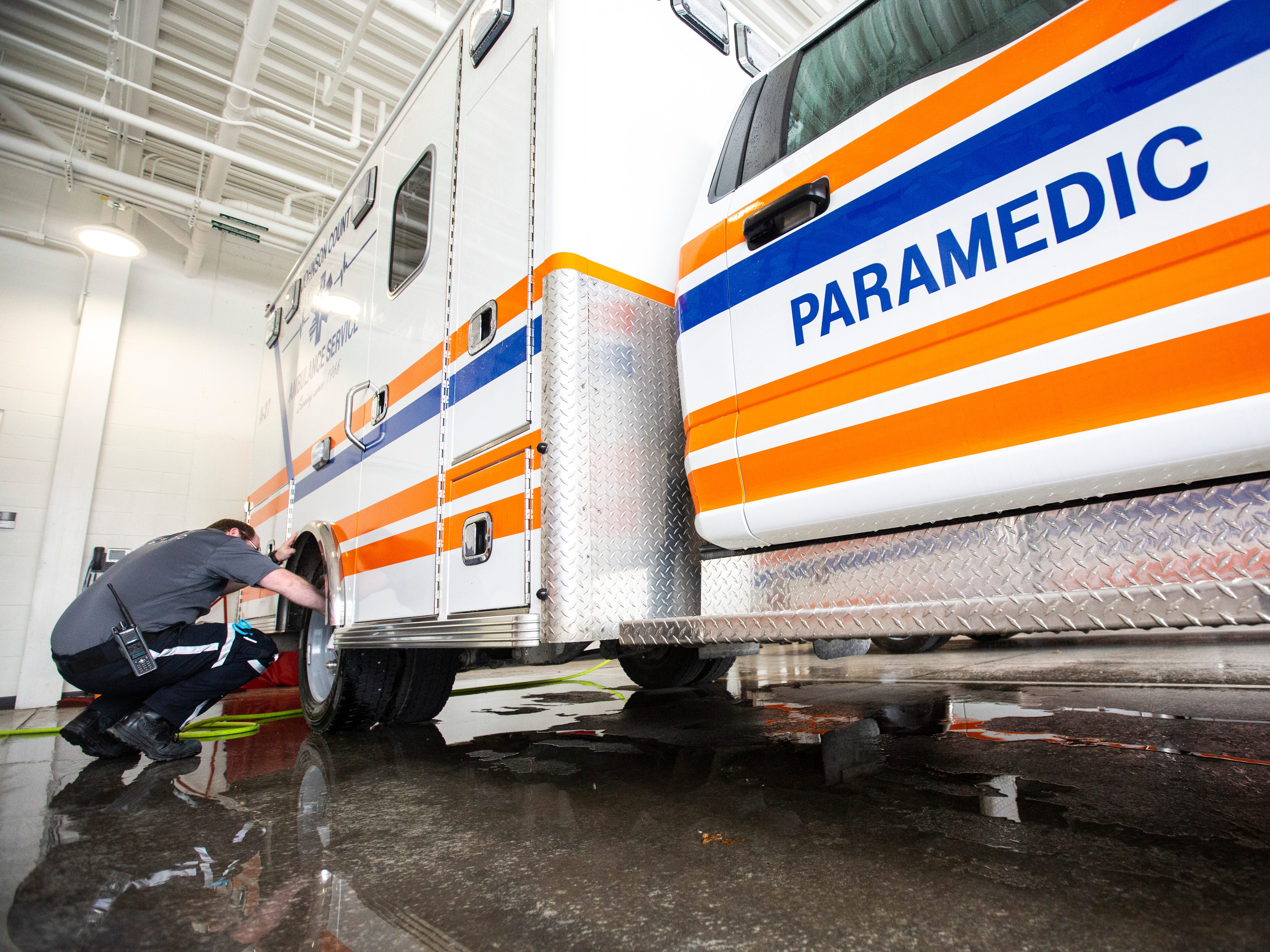 Zack Berger of the Johnson County Ambulance Service cleans their 2017 Ford F-450 truck on Wednesday, April 17, 2019, at the Johnson County Ambulance Services building at 808 S. Dubuque Street in Iowa City, Iowa.