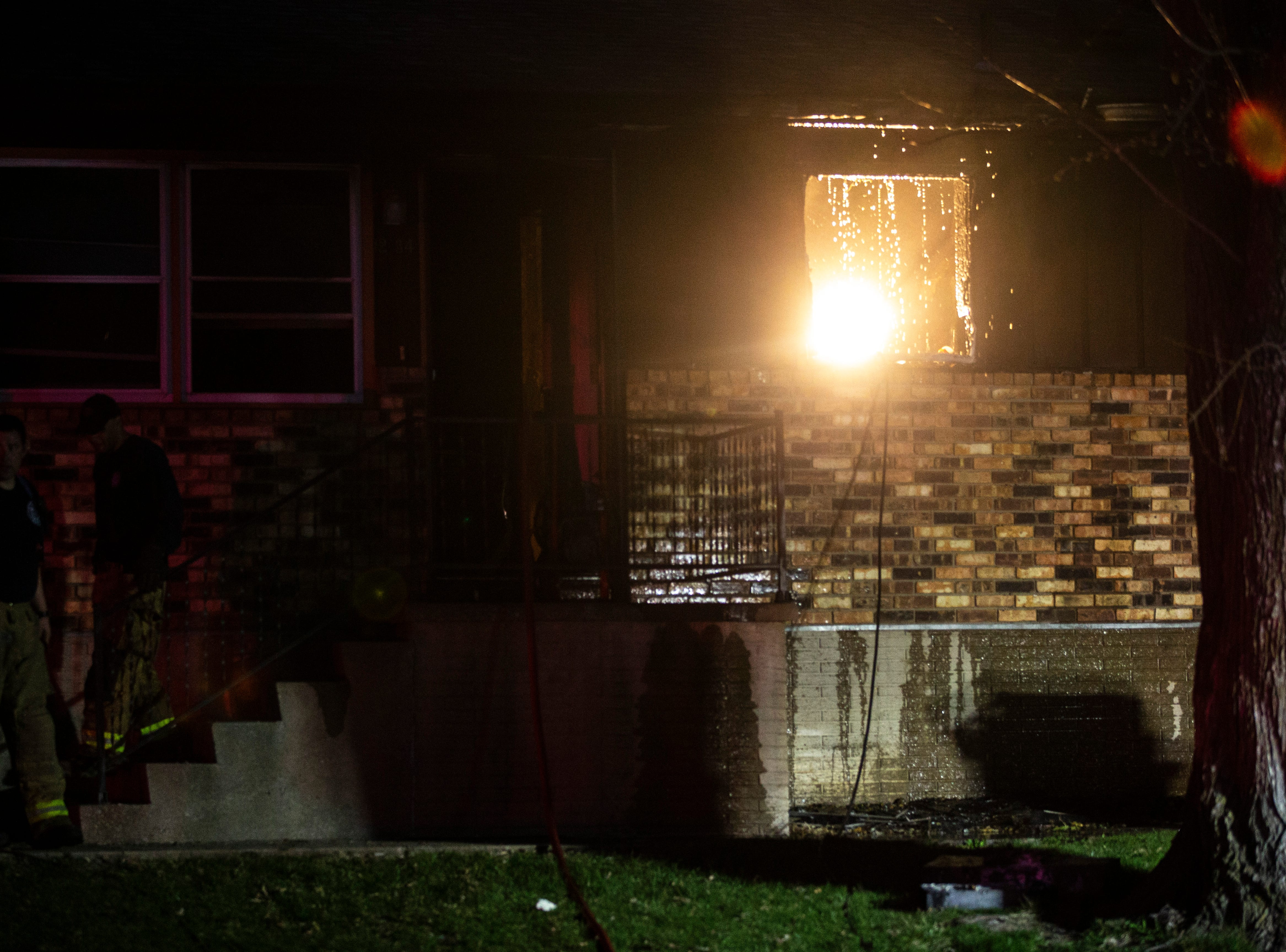 Firefighters respond to a structure fire at the east side of a duplex on Tuesday, April 16, 2019, in the 1200 block of Sandusky Drive in Iowa City, Iowa.