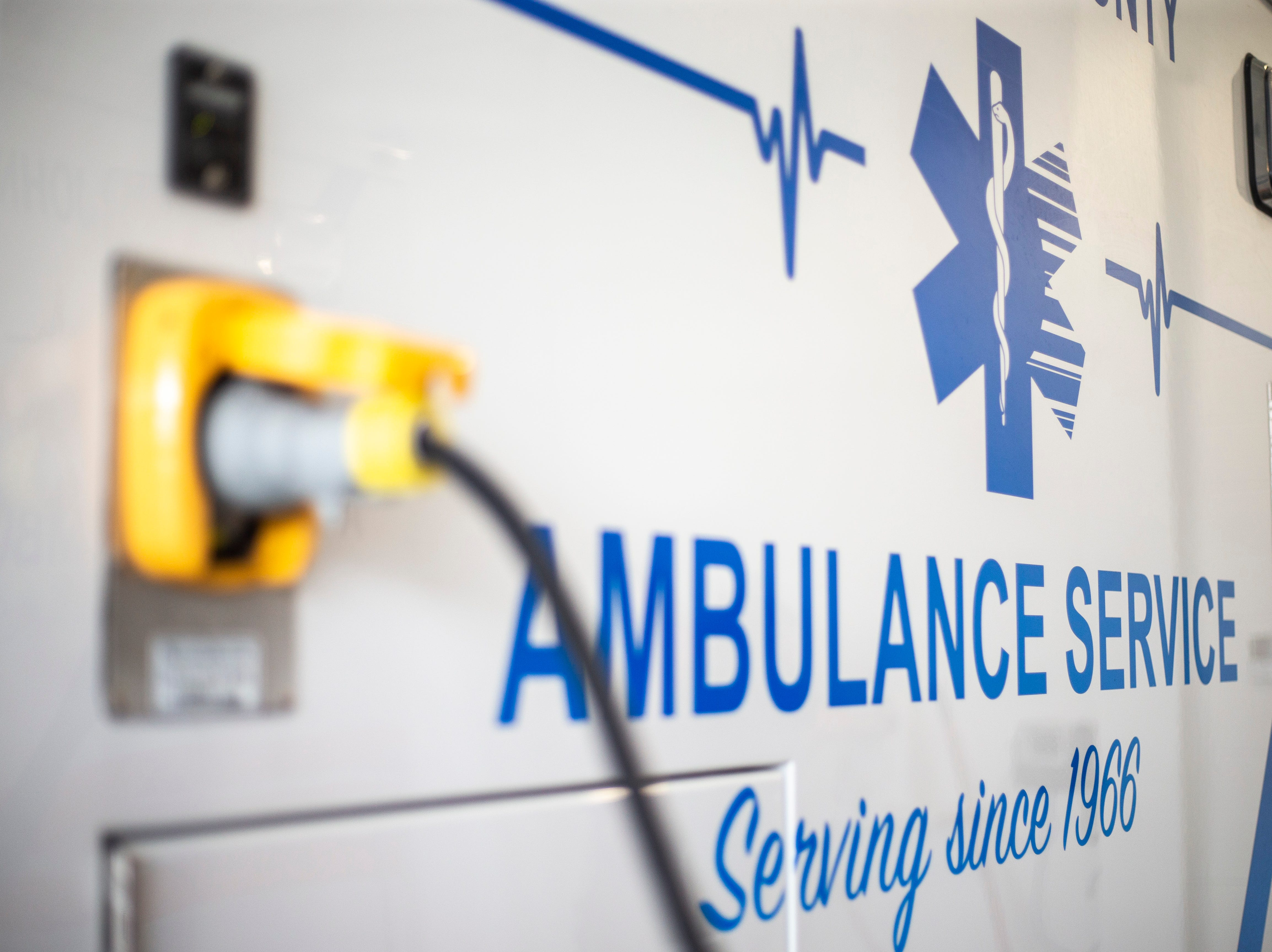 A plug charges up an ambulance on Wednesday, April 17, 2019, at the Johnson County Ambulance Services building at 808 S. Dubuque Street in Iowa City, Iowa.