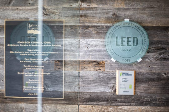 A LEED, Leadership in Energy and Environmental Design, Gold marker hangs in the entryway on Wednesday, April 17, 2019, at the Johnson County Ambulance Services building at 808 S. Dubuque Street in Iowa City, Iowa.