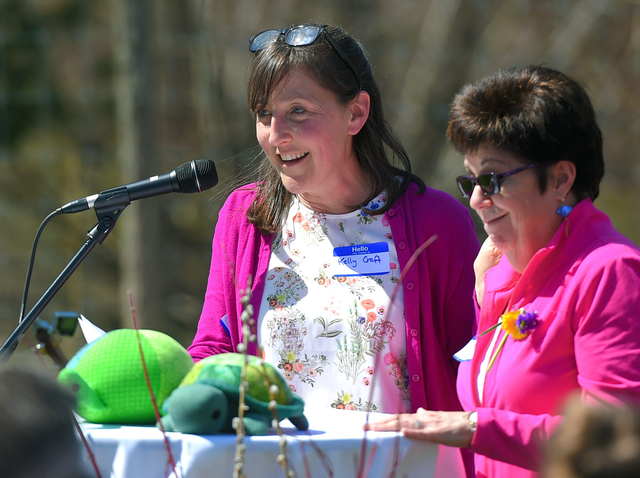 Kelly Craft, friend and colleague of Kathleen Downes, addresses the crowd at the celebration of life for Downes at Ithaca Children's Garden on April 17, 2019.