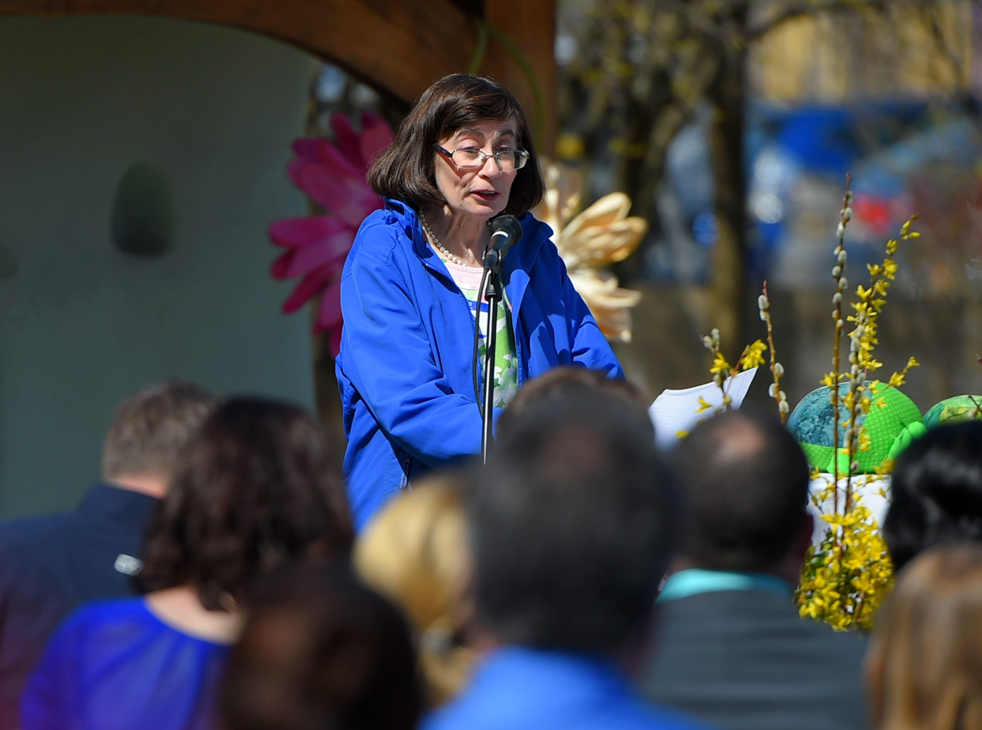 Carol Hockett, friend and colleague of Kathleen Downes, speaks at the celebration of life honoring Downes, held at the Ithaca Children's Garden on April 17, 2019.