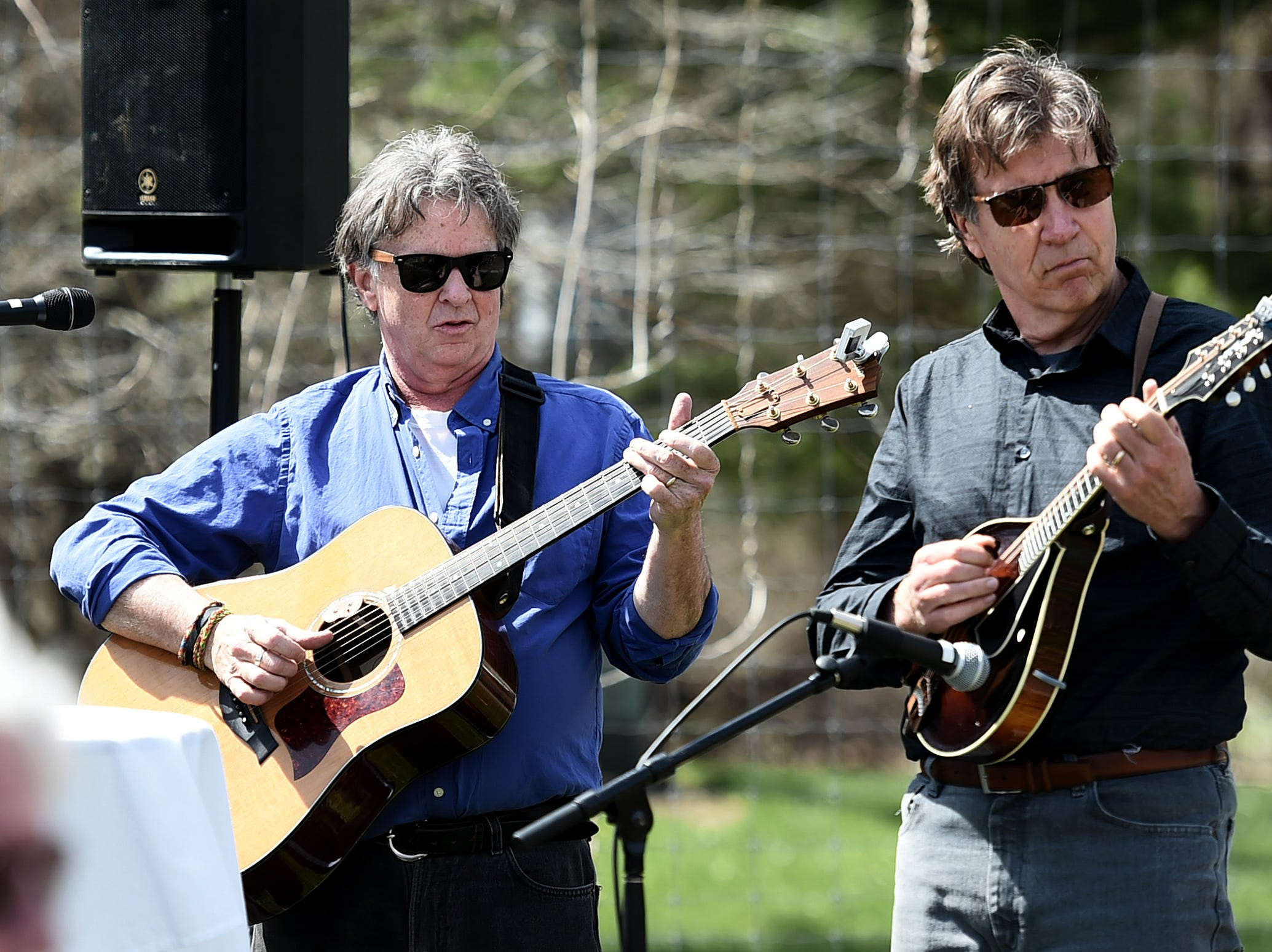 John Simon and Rick Manning open the celebration of life honoring Kathleen Downes with music at the Ithaca Children's Garden on April 17, 2019.