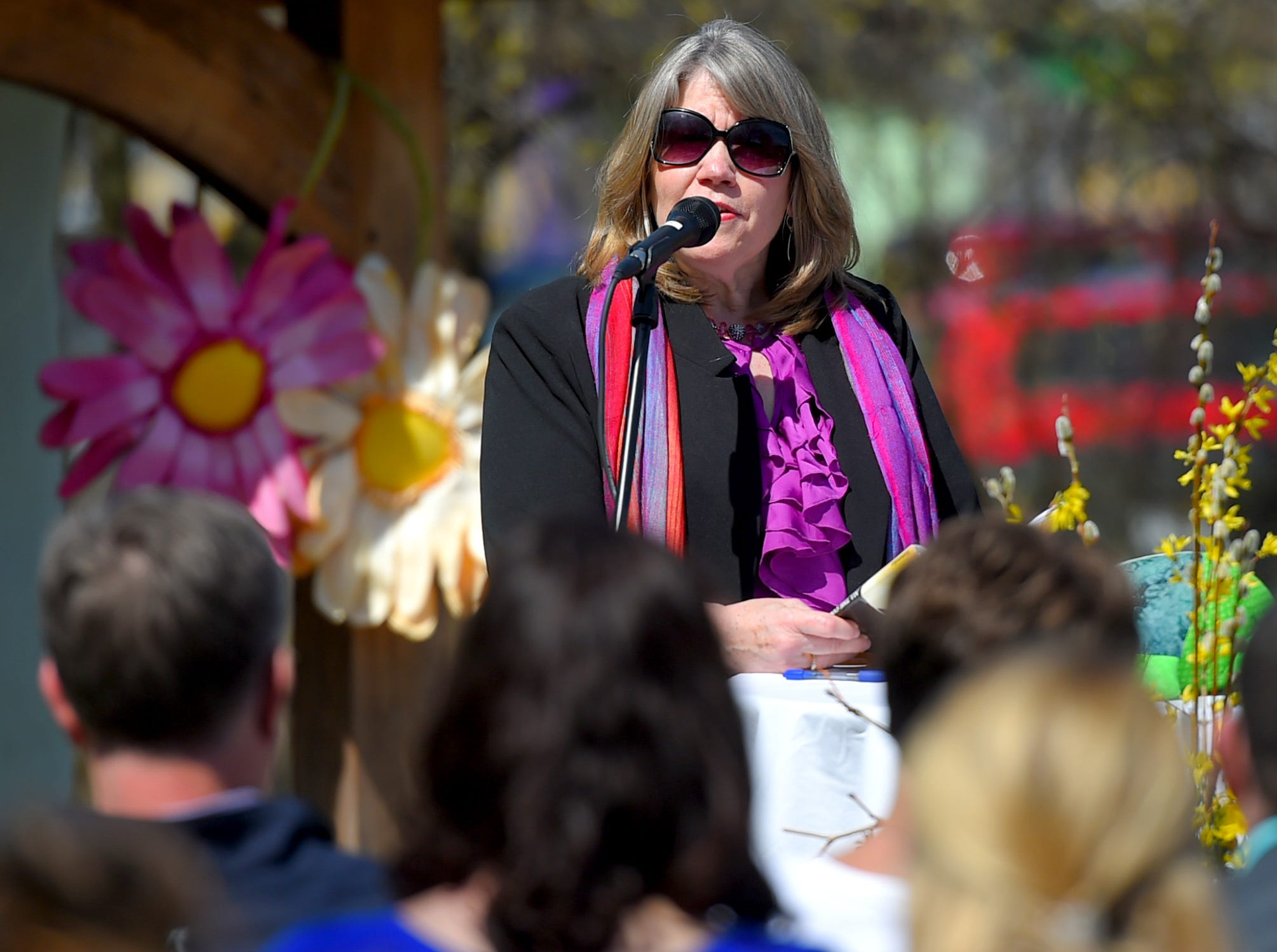 Brigid Hubberman, friend and colleague of Kathleen Downes, speaks at the celebration of life honoring Downes, held at the Ithaca Children's Garden on April 17, 2019.
