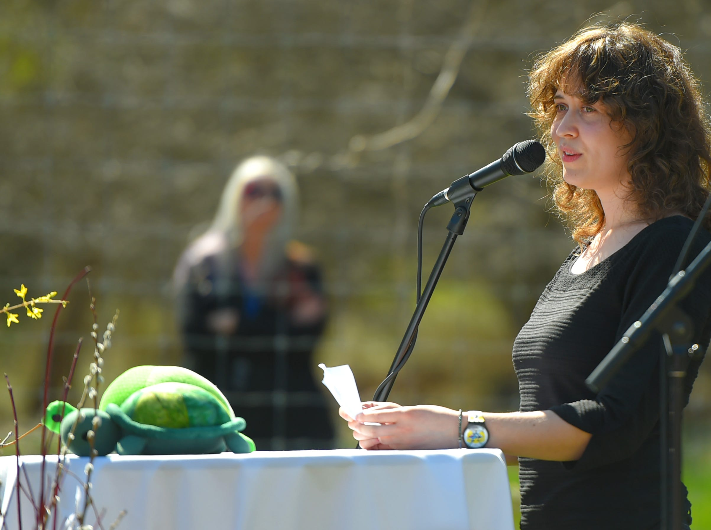 Rebecca Spiro, daughter of Kathleen Downes, remembers her late mother at the Ithaca Children's Garden on April 17, 2019. Downes, a beloved Ithaca teacher, died unexpectedly last week in a car accident.