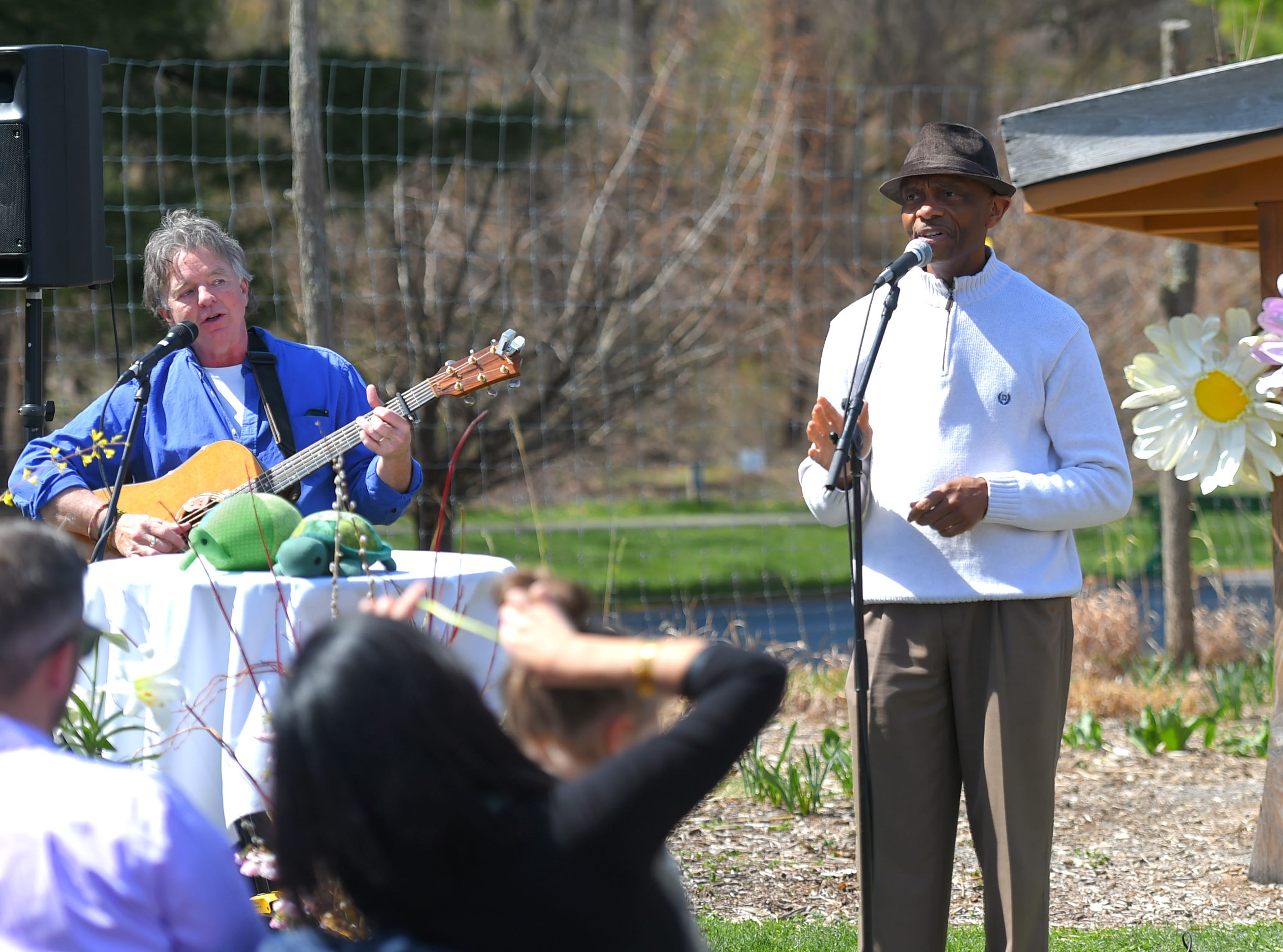 John Simon and Cal Walker sing during the celebration of life honoring Kathleen Downes at the Ithaca Children's Garden on April 17, 2019. Downes, a beloved Ithaca teacher, died unexpectedly last week in a car accident.