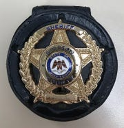 A Simpson County Sheriff's Dept. badge is shown in this photo.