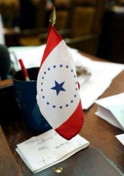 A proposed state flag designed by Jackson artist Laurin Stennis sits on a desk at the Capitol in Jackson, Miss. in this 2016 photo.