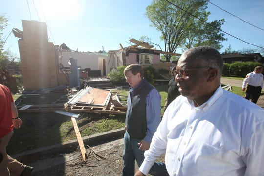 Mayor George Flaggs, Jr. and Lt. Gov. Tate Reeves walk along Jeanette Street in Vicksburg, Miss., Tuesday, April 16, 2019, surveying the storm damage following Saturday evening's tornados that swept through Vicksburg and Warren County.