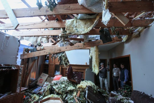 Pat McGuffie speaks with Warren County Sheriff Martin Pace and Lt. Gov. Tate Reeves about the damage at his home in Warren County, Miss., Tuesday, April 16, 2019, following Saturday evening's tornados that swept through Vicksburg and Warren County.