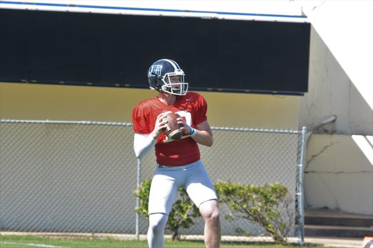 Jackson State quarterback Derrick Ponder drops back to pass during practice Tuesday, April 17, at Veteran's Memorial Stadium