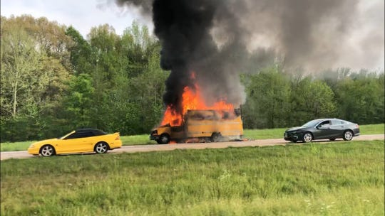 A moving truck burns on the side of the road on Interstate 40 on Wednesday afternoon.