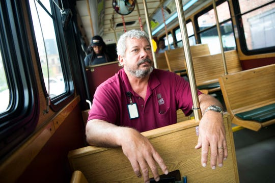 Trolley driver Barry Moretz rides the free orange line trolley while training a new driver, in Knoxville Wednesday, April 17, 2019. The trolley line could soon expand to service South Knoxville.
