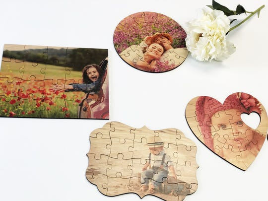 Photos can be printed on wood and cut into a jigsaw puzzle at Picture It Custom. Choose from a heart, circle or rectangle or three more unusual shapes named after towns, Crystal Copeland has lived in, such as Brandywine, Dayton and Franklin.