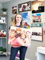 Picture It Custom founder Crystal Copeland in her Fountain City showroom on April 15. Photos can be printed on canvas or metal and hand wrapped around the wooden frames. Everything is constructed in-house.