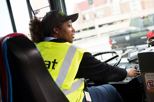 Driver Andé Bond of Rockford opens the doors to riders of the free Orange Line trolley in Knoxville on April 17, 2019. The trolley line could soon expand to service South Knoxville.