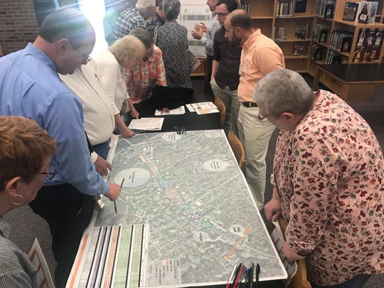 Residents gather around plans developed by the Knoxville Regional Transportation Planning Organization to help make South Knoxville's Chapman Highway safer.