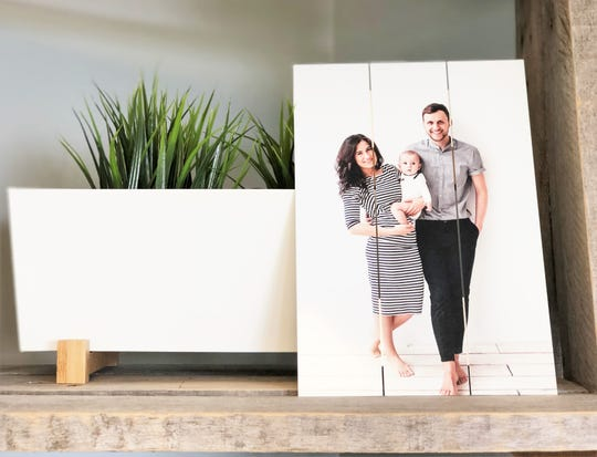 Crystal Copeland likes to update her family photo wall every year and wanted to print photos on palette wood to add a rustic touch. The idea helped spark the business idea behind Picture It Custom.