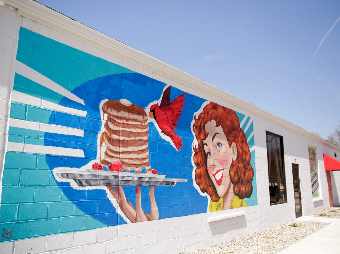 One of the completed murals on the side of Trish's Red Bird Cafe painted by Alexandria Monik, Tuesday, April 16, 2019, in Dayton.