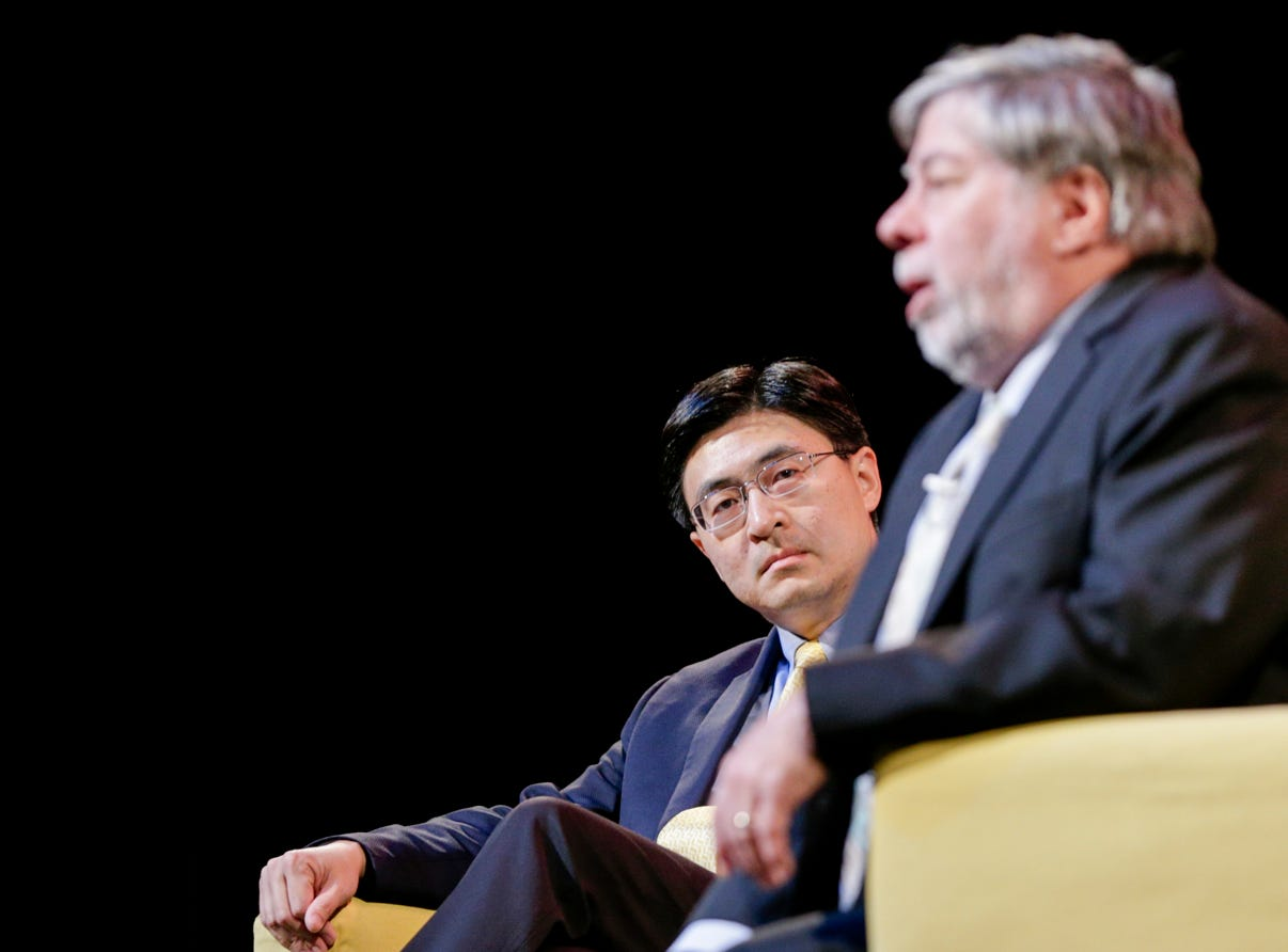 """Mung Chiang, dean of the College of Engineering, listens as Apple co-founder Steve Wozniak speaks with speaks, Wednesday, April 17, 2019 at Purdue University's Elliott Hall of Music in West Lafayette. The talk, """"What If We Lose Control of Technology?,"""" is part of Purdue's Ideas Festival, a series of events tied to the university's 150th anniversary."""
