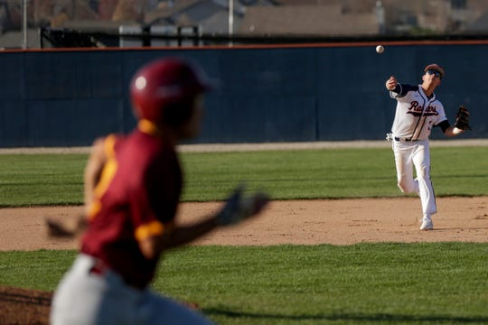 Harrison short stop Trey Cochran (3) throws to first to out the runner during the third inning of a high school baseball game, Tuesday, April 16, 2019, at Harrison High School in West Lafayette. McCutcheon won, 8-3.
