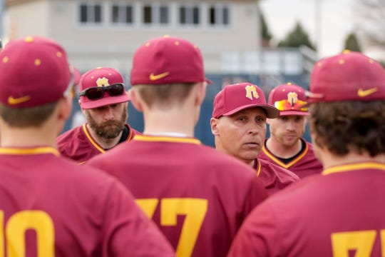 McCutcheon head coach Doug Schreiber speaks with the team after defeating Harrison, 8-3, Tuesday, April 16, 2019, at Harrison High School in West Lafayette.