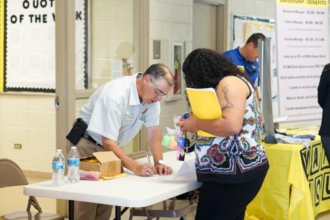 The Louisiana Workforce Commission and the Lafayette Economic Development Authority hosts a job fair for workers at the Walmart on the Evangeline Thruway in Lafayette, which is set to close next month.