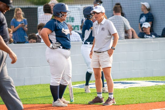 STM's head coach Andria Waguespack talks to Emily Landry at home plate as the St. Thomas More Lady Cougars take on the Vandebilt Catholic Terriers at home on Tuesday, April 16, 2019.