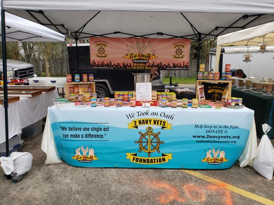 "2 Navy Vets Foundation set up tent with their homemade seasoning ""Clap-N-Praise"" seasoning"