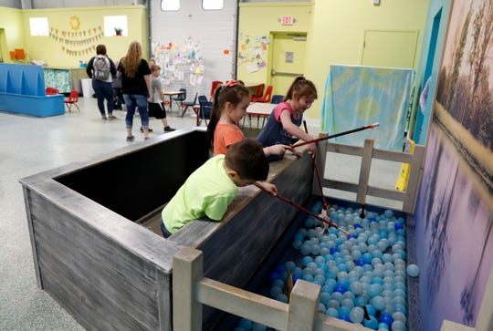 Children play in one of the indoor finishing play space Wednesday, April 17, 2019, at AHA! A Hands On Adventure, a Children's Museum in Lancaster. The museum won the 2018 Ohio Museum Association Institution of the Year Award earlier this week.