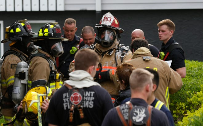 Dozens of fire fighters from around the county fought a fire at Somerford Square Apartments Wednesday, April 17, 2019, in Lancaster. One person was taken to the hospital.