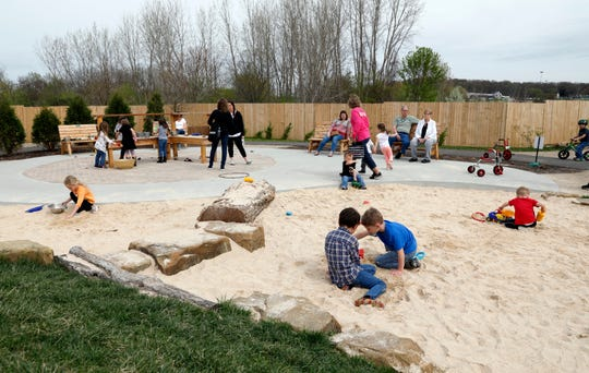 Children play in the sand area of the outdoor play space at AHA! A Hands On Adventure, a Children's Museum Wednesday, April 17, 2019 in Lancaster. The museum won the 2018 Ohio Museum Association Institution of the Year Award earlier this week.
