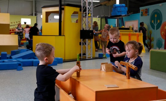Audrey Forquer, right, 7, from Lancaster, plays with her brothers Grant Forquer, 5, left, and Emmett Forquer, 2, center, Wednesday morning, April 17, 2019, at AHA! A Hands On Adventure, a Children's Museum in Lancaster. The museum won the 2018 Ohio Museum Association Institution of the Year Award earlier this week. The museum won the 2018 Ohio Museum Association Institution of the Year Award earlier this week.