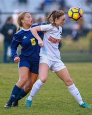 Hartland's Maria Storm (5) and Brighton's Abbigail Bowland battle for the ball during the Eagles' 3-1 victory on Tuesday, April 16, 2019.