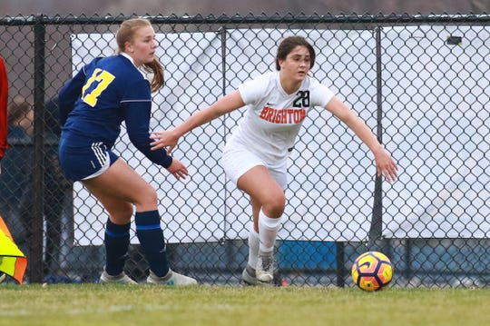 Tara Simon (28), who scored Brighton's goal in a 3-1 loss at Hartland, controls the ball while defended by Josie Huber on Tuesday, April 16, 2019.