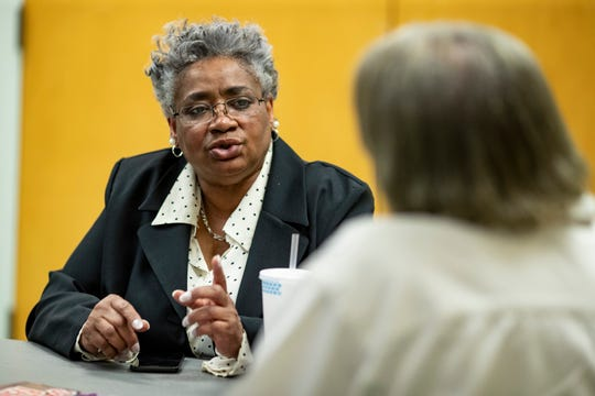 """Lecia Nolan, left, began pursuing a better understanding of how to save and achieve financial success through the Family Self Sufficiency Program. Today, she continues learning with adviser Joi Boyd. """"It became fun and then became interesting and now it's just a form of reinforcement,"""" Nolan said. April 16, 2019"""