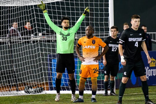 Michigan State's goalkeeper Isiah Handspike, left, calls out to teammates during the second half on Tuesday, April 16, 2019, at Cooley Law School Stadium in Lansing. The Lansing Ignite won the Capital Cup 4-0.