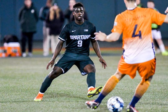 Michigan State's Farai Mutatu, left, closes in on Lansing Ignite's Grant Stoneman during the second half on Tuesday, April 16, 2019, at Cooley Law School Stadium in Lansing. The Lansing Ignite won the Capital Cup 4-0.