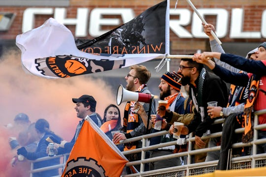 Lansing Ignite's supporters' group The Assembly Line cheers after Pato Botello Faz's goal during the first half on Tuesday, April 16, 2019, at Cooley Law School Stadium in Lansing.