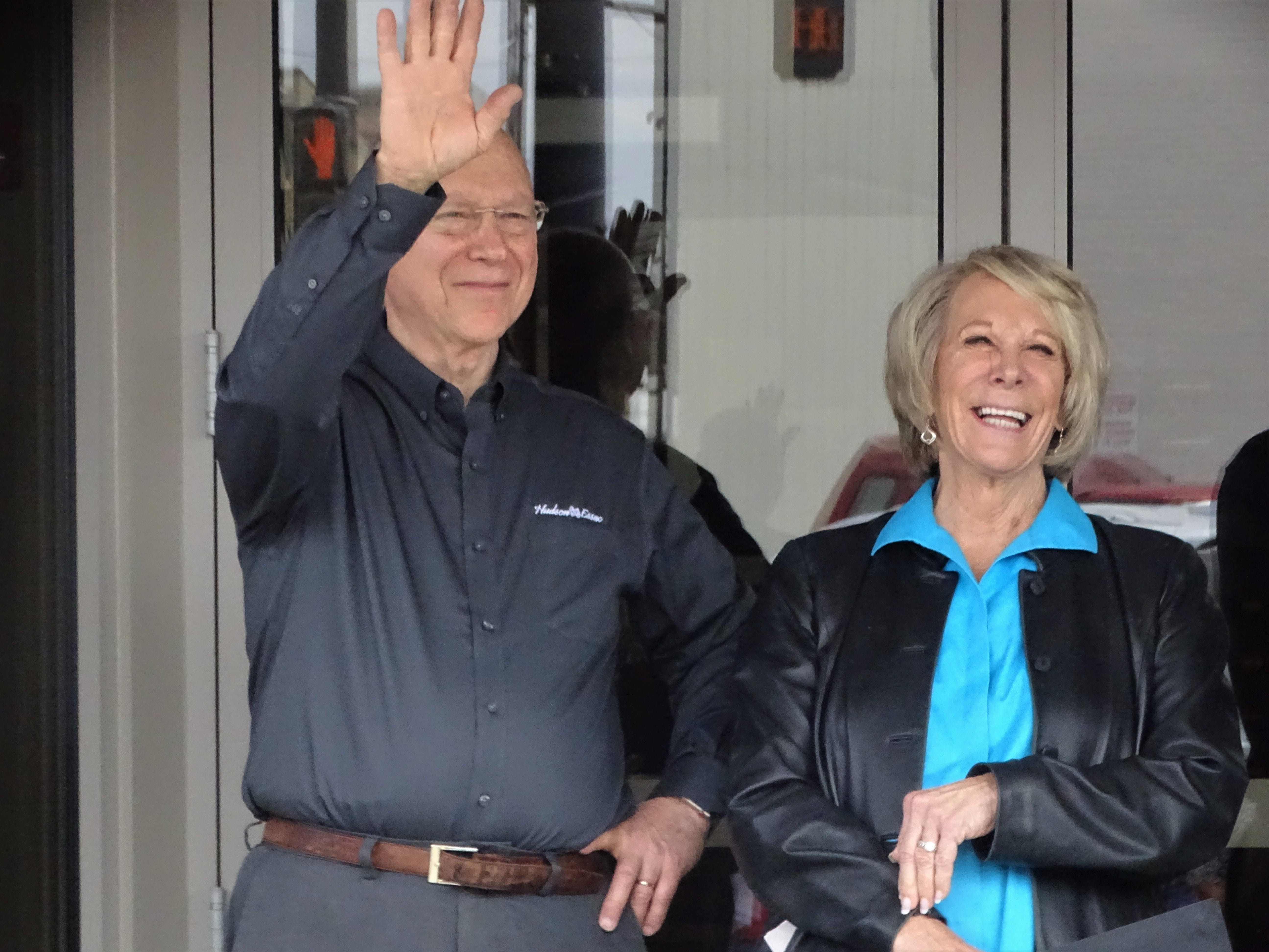 Owners Rick Taylor, waving to a friend in the crowd, and Carol Taylor celebrate the opening of their Hudson and Essex Deli on Wednesday.