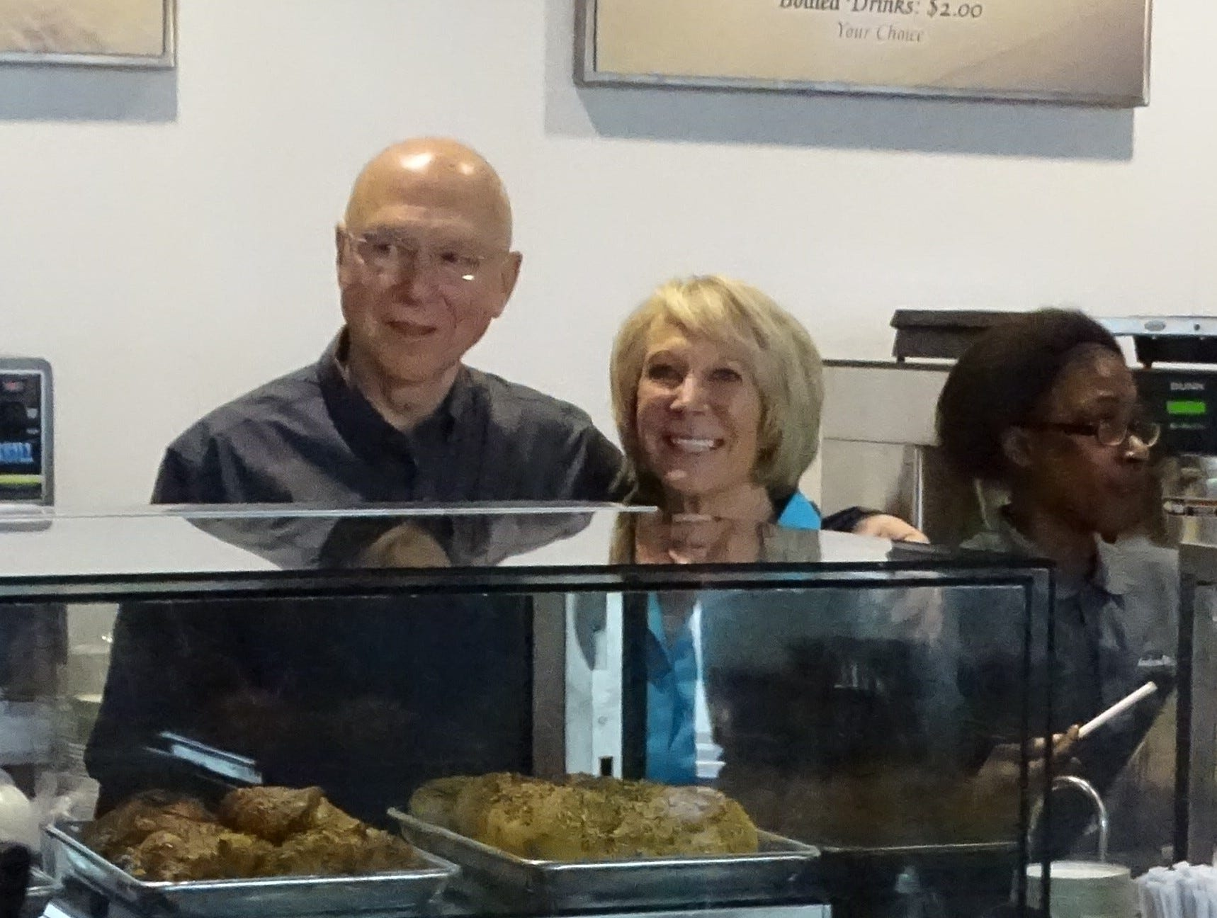 Rick and Carol Taylor, owners,  pause behind the pastry counter at the Hudson and Essex Deli.