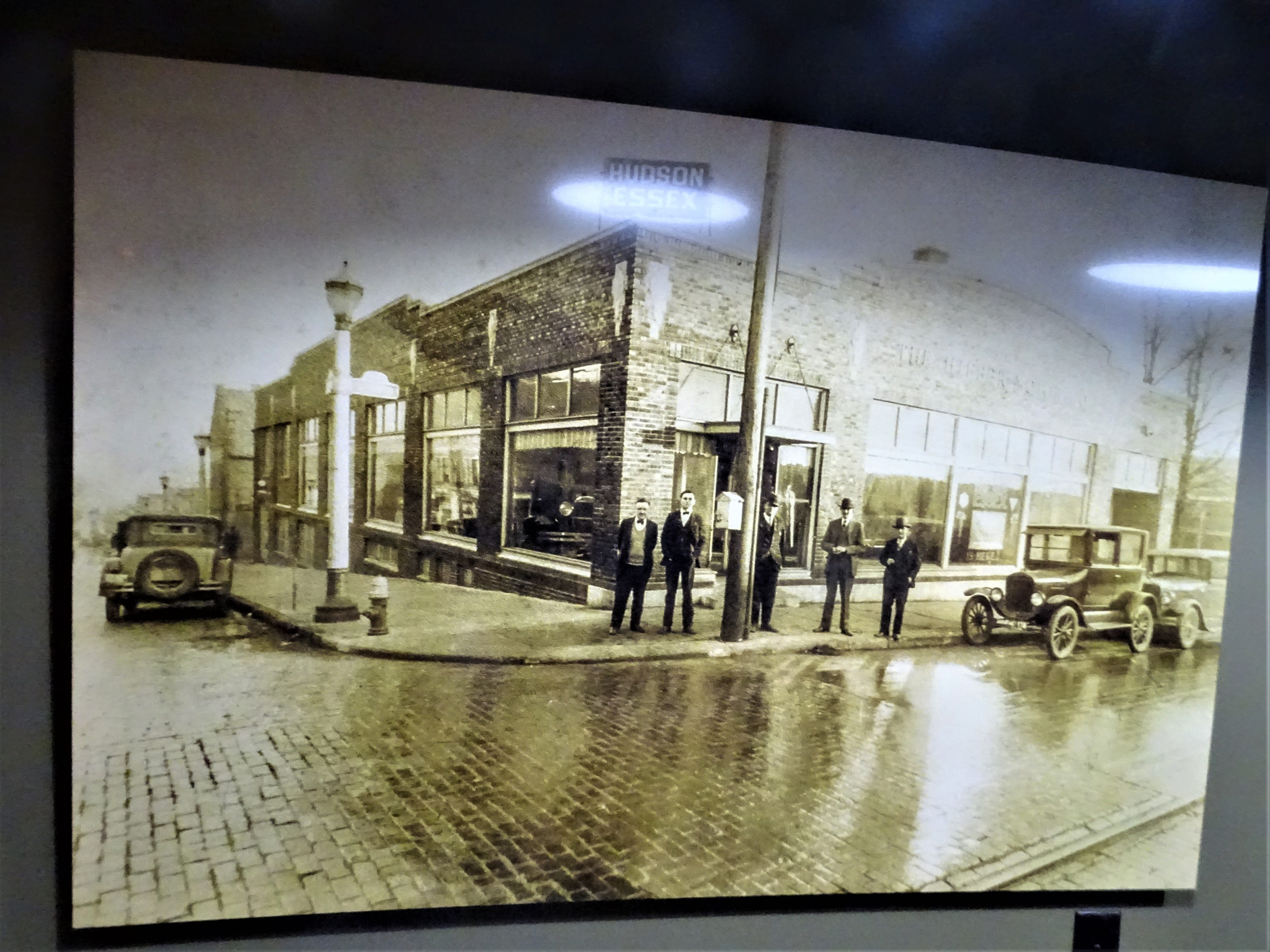 A photo hanging at Hudson and Essex shows the building when it was an auto dealership.